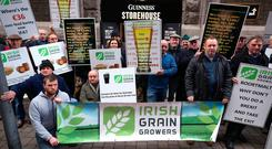Members of the Irish Grain farmers association return to protest outside the Guinness Storehouse over the poor prices that they are getting for malting barley. Photo: Damien Eagers