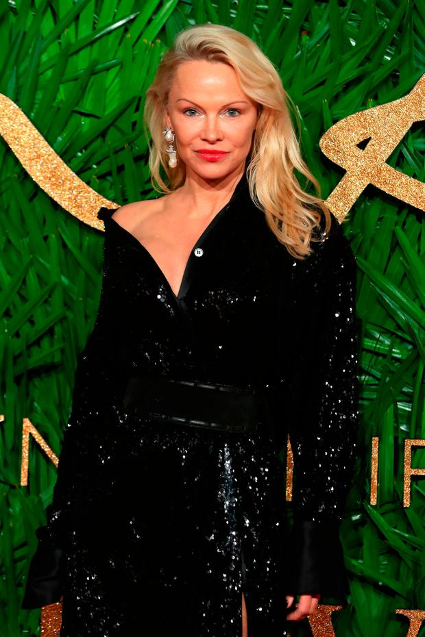 Canadian American actress, Pamela Denise Anderson poses on the red carpet upon arrival to attend the British Fashion Awards 2017 in London on December 4, 2017. / AFP PHOTO / Daniel LEAL-OLIVASDANIEL LEAL-OLIVAS/AFP/Getty Images
