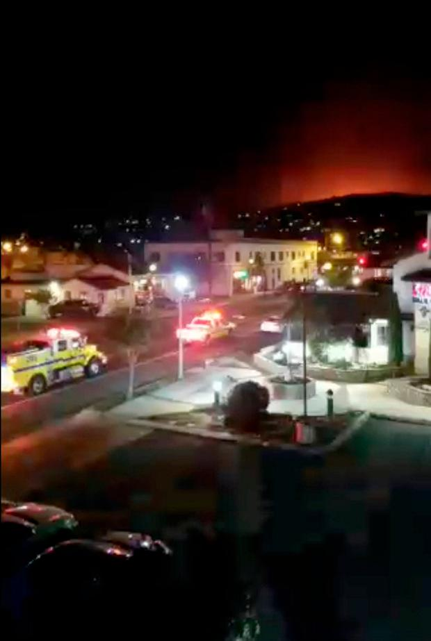 Fire engines gather as a brush fire spreads in Santa Paula, California, U.S. in this still image taken from a December 4, 2017 video taken from social media. James Fullmer/via REUTERS