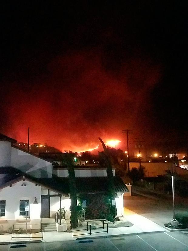 Flames are seen as a brush fire spreads in Santa Paula, California, U.S. in this December 4, 2017 picture taken from social media. James Fullmer/via REUTERSS