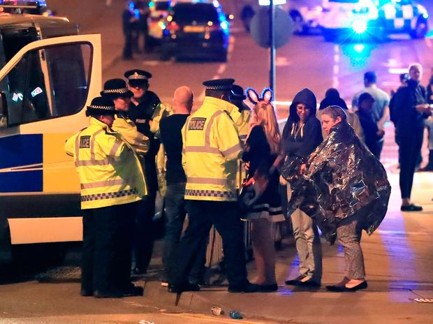 File photo dated 23/05/17 of emergency services at Manchester Arena after an explosion at the venue during an Ariana Grande gig. Peter Byrne/PA Wire
