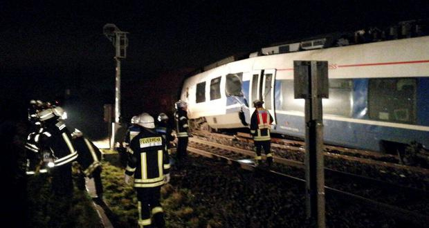 Rescue workers are pictured at the site of train crash in Meerbusch west of Duesseldorf, Germany