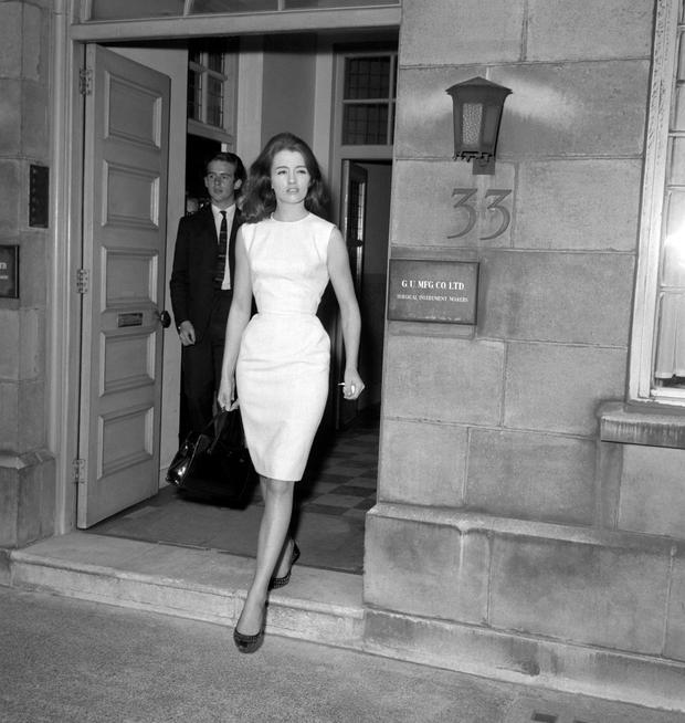 File photo dated 31/07/63 of Christine Keeler leaving her flat in London, as she has died at the age of 75. PRESS ASSOCIATION Photo. Issue date: Tuesday December 5, 2017. See PA story DEATH Keeler. Photo credit should read: PA/PA Wire