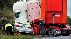 Gardaí at the scene of the crash in Co Wexford in which Doug Jnr, Stephen, Doug Snr and Lily Alexander died. Photo: Steve Humphreys