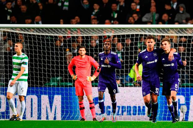 Anderlecht's Belgian midfielder Leander Dendoncker (2nd R) and Anderlecht's Belgian midfielder Pieter Gerkens (R) celebrates the own goal scored by Celtic's Croatian-born Bosnian defender Jozo Simunovic (L) during the UEFA Champions League Group B football match between Celtic and Anderlecht at Celtic Park stadium in Glasgow, Scotland on December 5, 2017. / AFP PHOTO / Andy BUCHANANANDY BUCHANAN/AFP/Getty Images