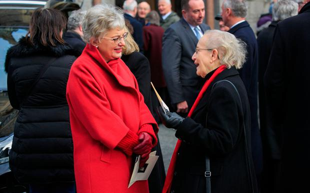 Children's Minister Katherine Zappone with retired Supreme Court judge Catherine McGuinness at the funeral. Photo: Gareth Chaney Collins