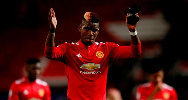 Manchester United's Paul Pogba under fire from Paul Scholes. Action Images via Reuters/Jason Cairnduff