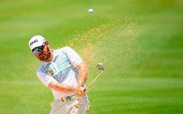 BEL OMBRE, MAURITIUS - DECEMBER 03: Louis Oosthuizen of South Africa plays his second shot on the par four 9th hole during the final round of the AfrAsia Bank Mauritius Open at Heritage Golf Club on December 3, 2017 in Bel Ombre, Mauritius. (Photo by Ross Kinnaird/Getty Images)