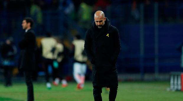 Soccer Football - Champions League - Shakhtar Donetsk vs Manchester City - Metalist Stadium, Kharkiv, Ukraine - December 6, 2017 Manchester City manager Pep Guardiola looks dejected Action Images via Reuters/Andrew Couldridge