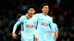 Tottenham Hotspur's Son Heung-Min (left) celebrates scoring his sides second goal of the game during the UEFA Champions League, Group H match at Wembley Stadium, London. PRESS ASSOCIATION Photo. Picture date: Wednesday December 6, 2017. See PA story SOCCER Tottenham. Photo credit should read: Adam Davy/PA Wire