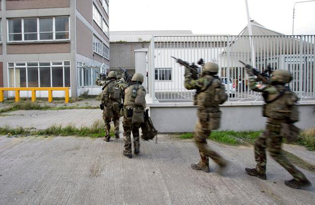 Members of the Defence Forces take part in a terror scenario based on a knife attack at Pearse Street rail station yesterday