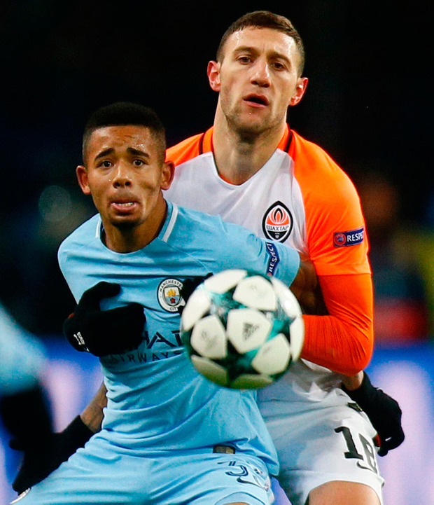 Manchester City's Gabriel Jesus challenges for the ball with Shakhtar's Ivan Ordets. Photo: AP