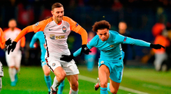 Manchester City's Leroy Sane drives at Shakhtar Donetsk's Ivan Ordets. Photo: Getty Images