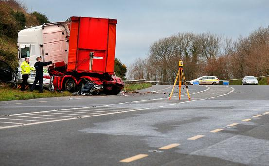 Gardai at the scene of the fatal crash between a rental car and a truck which saw four members of the Alexander family killed in Cushinstown Co Wexford. Photo: Steve Humphreys