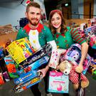 St Vincent de Paul volunteers Ross McDermott and Alexandra Flood at the charity's sorting warehouse in Dublin with some of the donated toys. Photo: Steve Humphreys