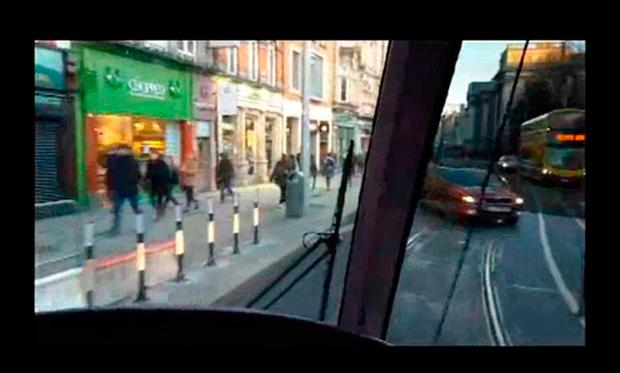 A scene from the garda safety video which highlights offences witnessed on Luas tracks