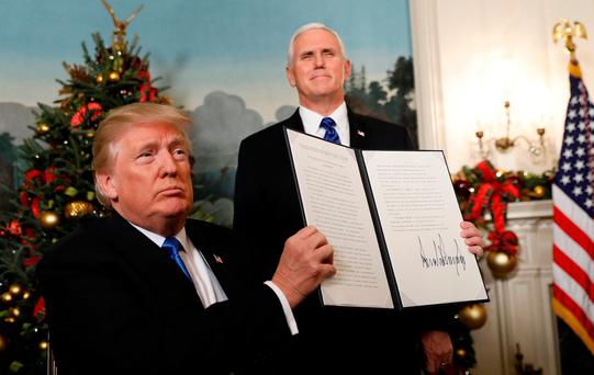 After signing, US President Donald Trump holds up the proclamation that the United States recognises Jerusalem as the capital of Israel and will move its embassy there, during an address from the White House in Washington. Photo: Reuters