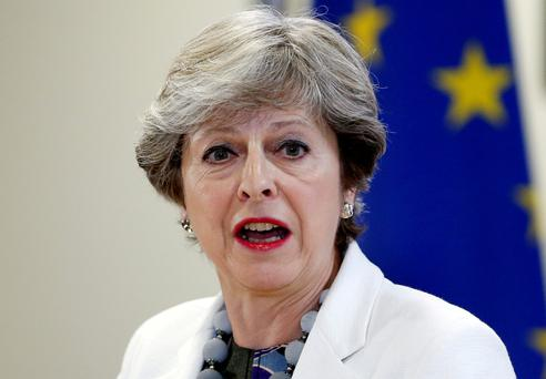 Britain's Prime Minister Theresa May addresses a news conference during an European Union leaders summit in Brussels, Belgium, October 20, 2017. REUTERS/Francois Lenoir/File Photo