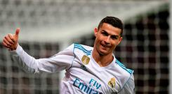 TOPSHOT - Real Madrid's Portuguese forward Cristiano Ronaldo thumbs up during the UEFA Champions League group H football match Real Madrid CF vs Borussia Dortmund at the Santiago Bernabeu stadium in Madrid on December 6, 2017. / AFP PHOTO / JAVIER SORIANOJAVIER SORIANO/AFP/Getty Images