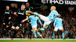 David Silva acrobatically puts Manchester City ahead late on in last weekend's game against West Ham. Photo: Getty