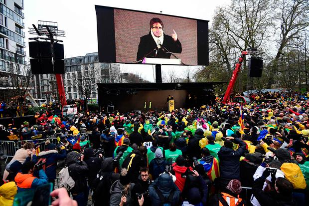 Supporters listen to a speech by Catalonia's deposed regional president Carles Puigdemont in Brussels yesterday. Photo: Getty Images