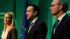 Taoiseach Leo Varadkar (centre), Tanaiste Simon Coveney (right) and Minister for European Affairs Helen McEntee speaking at the Government Press Centre in Dublin after the European Commission announced that