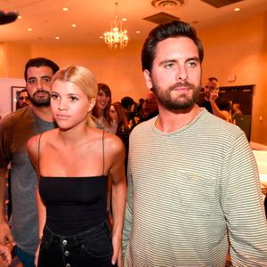 Sofia Richie (L) and Scott Disick attend Haute Living's VIP Pop-Up opening of Alec Monopoly from Art Life and David Yarrow from Medal's Gallery at Fleur De Lis Ballroom, Fontainebleau Miami Beach on December 7, 2017 in Miami Beach, Florida. (Photo by Romain Maurice/Getty Images for Haute Living)
