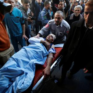 A Palestinian man who was wounded during clashes with Israeli troops