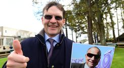 Aidan O'Brien holds a picture of Bobby Frankel as he gives the thumbs-up after equalling the America trainer's Group One winners' record at Ascot with Hydrangea. Photo: Healy Racing
