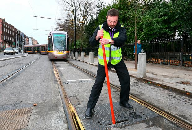Luas driver team leader and incident manager Philip Eyre changing the points manually at the top of Dawson Street / St Stephen's Green. Photo: Frank McGrath
