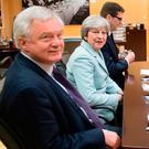 The British and European Union negotiating teams at a working breakfast in Brussels yesterday before the announcement of the deal