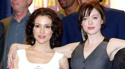 Alyssa Milano and Rose McGowan. LOS ANGELES - FEBRUARY 1: (from left to right) Actresses Alyssa Milano, Rose McGowan celebrate the WB's 'Charmed' 150th episode cake cutting on the set at Paramount Studios on February 1, 2005 in Los Angeles, California. (Photo by Kevin Winter/Getty Images)