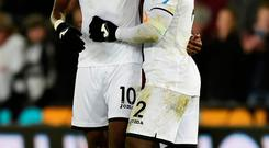 Swansea City's Wilfried Bony and Tammy Abraham celebrate