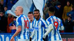 Huddersfield Town's Beninese striker Steve Mounie (C) celebrates scoring their second goal