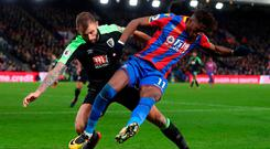 Crystal Palace's Wilfried Zaha in action with Bournemouth's Steve Cook. Photo: Hannah McKay/Reuters