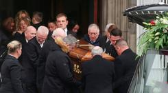 FAREWELL: Mourners carry Caine McCormack-Kirwan's coffin