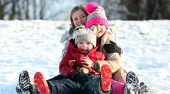 PISTE PROJECT: Jack (5), sister Mia (10) and friend Rachel (11) sledging at Stormont in Belfast. Photo: Matt Mackey/Presseye.com