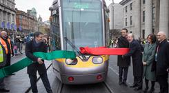 ALL TOGETHER NOW: It takes three Ministers of Transport, two former, one current, to launch the cross-city Luas yesterday