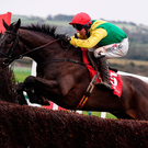 Sizing John, with Robbie Power up, jump the last, on their way to winning the John Durkan Memorial Punchestown Steeplechase at Punchestown Racecourse in Naas