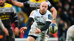 Wasps scrum-half Joe Simpson (C) passes the ball. Photo: Getty Images