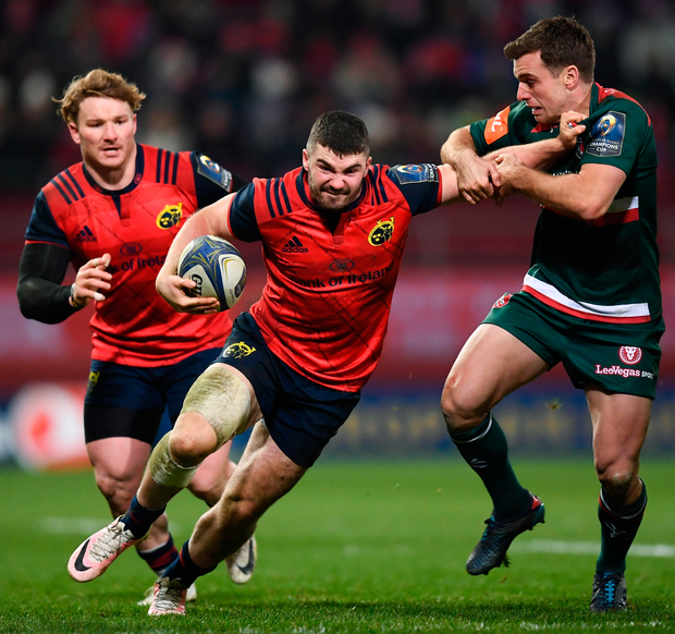 Sam Arnold of Munster is tackled by George Ford of Leicester Tigers. Photo: Sportsfile