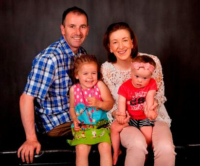 Pat and Ciara Reid with daughters Dearbhla (4) and Réiltín (2).