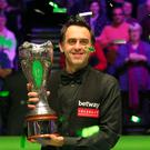 Ronnie O'Sullivan poses with the trophy after winning the Betway UK Championship at the York Barbican, York. PRESS ASSOCIATION Photo.