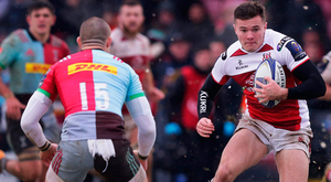 Ulster's Jacob Stockdale tries to evade the clutches of Mike Brown of Harlequins. Photo: Getty Images