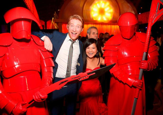 Irish actor Domhnall Gleeson and Kelly Marie Tran pose with the Praetorian Guard at the world premiere of 'Star Wars: The Last Jedi' in Los Angeles, California, last night. Photo: Getty Images