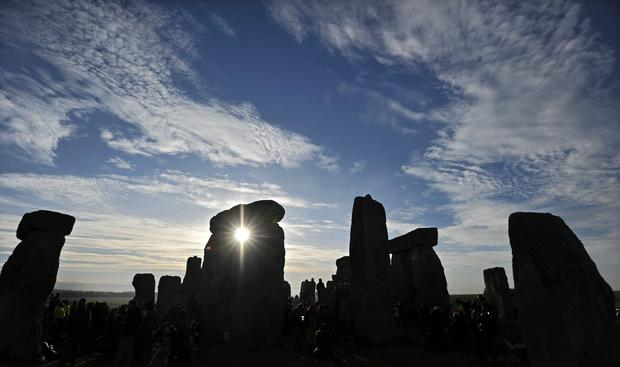The sun rises behind Stonehenge in Wiltshire, England. Photo: AFP/Getty Images