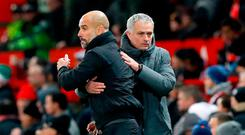 Manchester City manager Pep Guardiola (left) and Manchester United manager Jose Mourinho after the final whistle
