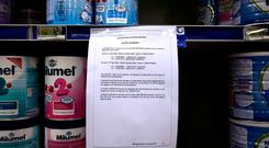 A notice warns customers of precautionary recall of products in a supermarkert of Lille, northern this week. Baby milk maker Lactalis and French authorities have ordered a global recall of millions of products over fears of salmonella bacteria contamination. (AP Photo/Michel Spingler)