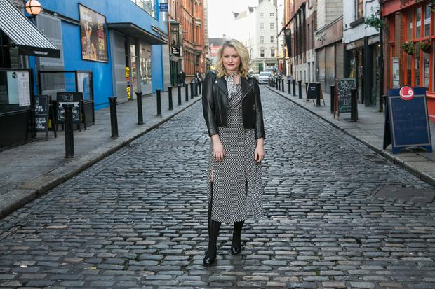 Lorna Claire Weightman styling over the knee boots. Lorna wears: boots by Christian Louboutin, €895 at Brown Thomas; dress by Rixo, €315 at Brown Thomas; Jacket, Ganni,€549 at Brown Thomas. Picture: Kyran O'Brien