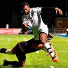 Clermont's Fijian wing Alvereti Raka breaks through a tackle to score the opening try during their Champions Cup match at Allianz Park last night. Photo: Getty Images